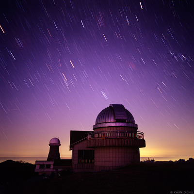 ikenbot:  Under the Canopy of Stars  The SoBaekSan National Observatory in Korea is photographed during the great Leonid meteor shower in 2001. Visible in the background are several Leonid meteors among startrails in this long exposure image.  I think this is the meteor shower my dad woke us up at 4am for… The memory will stick with me as one of the happiest I have with him.