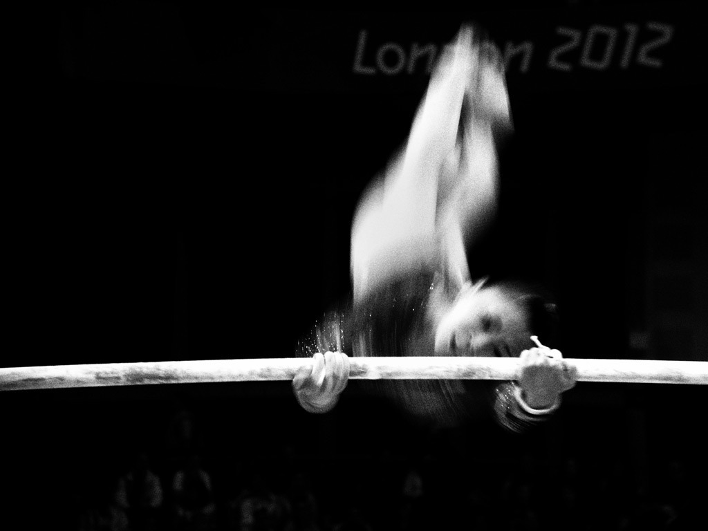 The Guardian Eyewitness Series: London 2012   China's He Kexin competes in the women's uneven bars at the North Greenwich arena  Photographer: Dan Chung for the Guardian