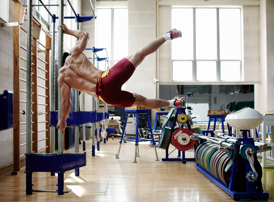 "Weightlifting Winners: Inside the Olympic Training Camp of China's World Record-Breaking Gold Medalists, by Noah Sheldon Nowness:  The intense preparations behind the success of China's weightlifting Olympic medal winners Lu Xiaojun, Li Xueying and Wu Jingbiao are revealed in Shanghai-based artist and photographer Noah Sheldon's portfolio. After obtaining access to the secretive National Sports Training Center in Beijing, Sheldon followed the Chinese Olympic weightlifting team's daily routines in the run up to the London 2012 Games, from dusting their palms with magnesium carbonate chalk to endless repetitions of the snatch and the clean-and-jerk lifts at ever-heavier weights. ""The athletes' lives are so regulated, every minute is controlled, but they really seem to have nice relationships with their coaches and each other,"" notes Sheldon. The Chinese team has been hugely successful this year, with four gold and two silver medals so far. While World Champion Wu Jingbiao failed his final lift in the 56kg division to come second, late call-up to the team Wang Mingjuan took the title in the women's 48kg competition, and Lu Xiaojun from Hubei Province broke the world records for both the snatch lift and total weight on the way to his Olympic crown. ""There's a close-up of him, when he's hanging off the bar sideways,"" says Sheldon. ""It's incredible if you see pictures of him three years ago––he was a sprinter and now he's the world's best lifter in his category."" But the nation's potential medal haul isn't over yet, as World Champion and world record holder Zhou Lulu competes today in the women's super heavyweight over 75kg category.  Noah Sheldon's complete set of weightlifters => HERE"