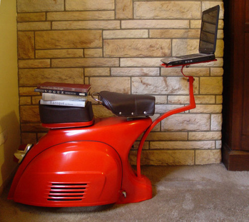 As i posted the Vespa movie today, here's an example of bringing a Vespa into your loft. 1968 Vespa Scooter Turned Into Functional Work Station.