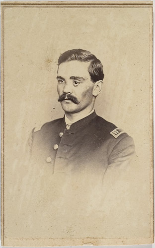"ca. 1860's, [carte de visite portrait of Capt. Irving F. Wilcox, 1st Michigan and Veteran Reserve Corps, post injury], Matthew Brady   Flowing ink inscription on verso reads, ""Yours Truly/I F Wilcox/14th Regt. VRC."" Wilcox enlisted in the 1st Michigan as Company A. First Sergeant in July 1861 and was present at Gaines Mill where he was wounded. Promoted to 1st Lieutenant Wilcox fought at 2nd Bull Run where he lost his left eye. The young officer convalesced and became Adjutant of the 1st Michigan before joining the Veteran Reserve Corps in September 1863 rising to the rank of Captain when this photograph was taken. Notice the scars from the August 1862 wound as well as the replacement glass eye.  via Cowan's Auctions"
