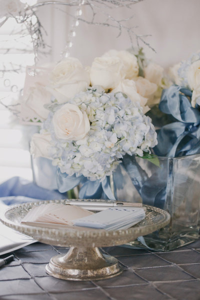 source: Style Me Pretty  ~ pretty pale blue hydrangeas & ribbons with creamy white roses