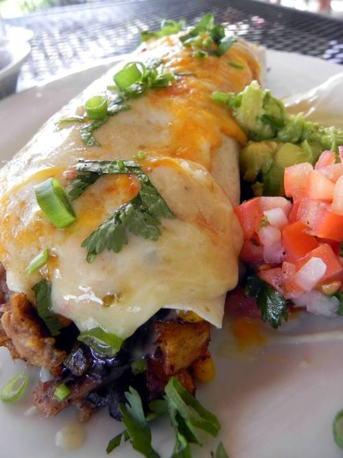 Roasted Pulled Pork Burrito with potato hash, black beans, cheddar cheese and cilantro from Santa Fe Restaurant