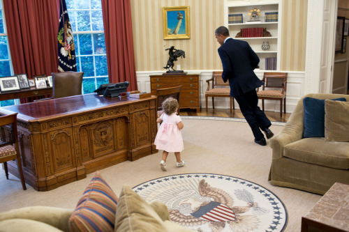 Obama being chased by a toddler.