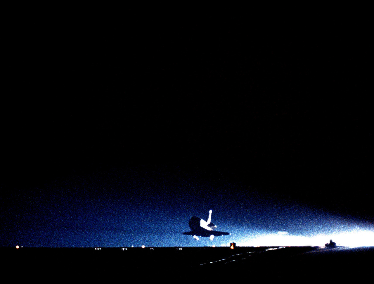 Touch Down!  The space shuttle orbiter Challenger (STS-8) makes the first nighttime landing of the Space Transportation System as it touches down on Runway 22 at 12:40 am PDT at the end of a six-day mission. Aboard the shuttle are: Richard H. Truly, commander; Daniel Brandenstein, pilot; and mission specialists Guion S. Bluford, Dale A. Gardner and Dr. William E. Thornton, 09/05/1983