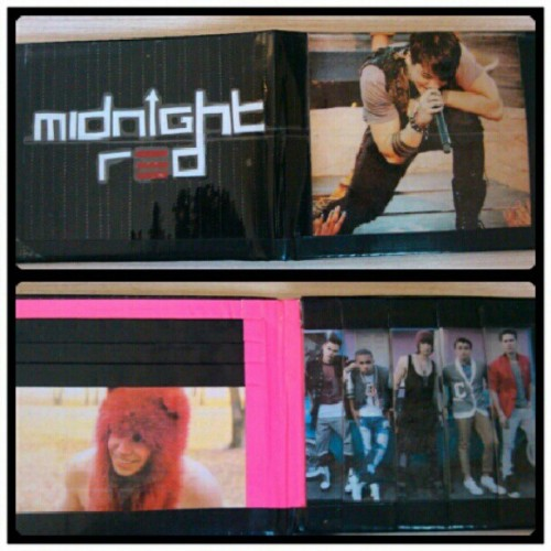 zackoid:  Better Pic of the @itsmidnightred #ducktapewallet I created =] (Taken with Instagram)