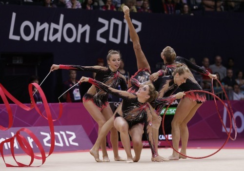 "nationalpostsports:  The team from Canada performs during the rhythmic gymnastics group all-around qualifications at the 2012 Summer Olympics.  This bullshit and trampoline are ""sports"" yet they disqualified baseball and haven't allowed Lacrosse or Rugby?"