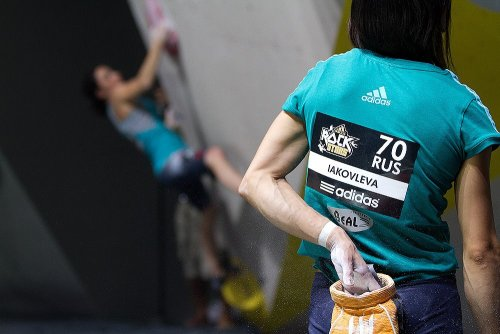 Olga Iakovleva (RUS) chalking up for her climb in the Adidas ROCK Stars comp Photo: Christian Waldegger