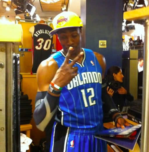 This has to hurt a little, Magic fans. Dwight Howard (in Orlando blue) sporting a Lakers hat.