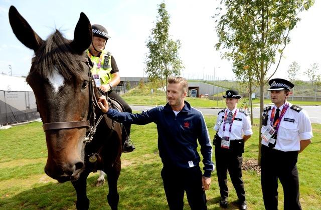 Becks canoodling with security staff at the Olympics via laineygossip.