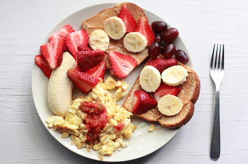 yummaystuff  scrambled eggs, peanut butter and fruit on bread.