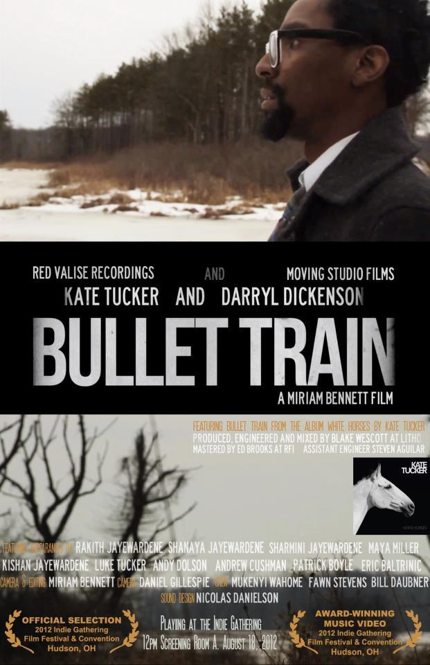 "The short film/music video Bullet Train is an official selection of the Indie Gathering International Film Festival and winner of Best Rock Video 2012. Directed by Akron-based filmmaker Miriam Bennett, produced by Moving Studio and Red Valise, Bullet Train features Cleveland filmmaker and actor Darryl Dickenson, Kate Tucker, and Luke Tucker. Indie Gathering International Film Festival takes place in Hudson, Ohio August 17-19.  Bullet Train screens on August 18, 2012. Director Miriam Bennett is an associate professor of Media Arts and Studies at Cuyahoga Community College. Bullet Train is one of seven Kate Tucker music videos she's made with her Moving Studio production company. ""We've filmed almost exclusively in Akron and when we've been elsewhere (like Seattle, New York, or Los Angeles) we've always had some sort of Northeast Ohio presence."" says Kate Tucker who was born in Akron, but has made her musical home in Seattle, Washington and now Nashville, Tennessee.  Bullet Train's entire cast and crew are from the Akron/Cleveland area and the shoot took place in areas in and around Akron, Ohio, including Suffield Township where Kate grew up with her brother Luke, who plays the hunter in the video. Akron's Stagecoach Antiques is featured in the opening scene and the graveyard is in Quail Hollow State Park. ""My brother and I spent countless hours exploring the trails of Quail Hollow, located just across the street from our childhood home. I was so excited when I convinced him to play a role in the video.  I think being in a familiar surrounding made it more comfortable for all of us, as opposed to being on a movie set.""The song Bullet Train is from Kate Tucker's White Horses LP released on Red Valise Recordings.  Steph"