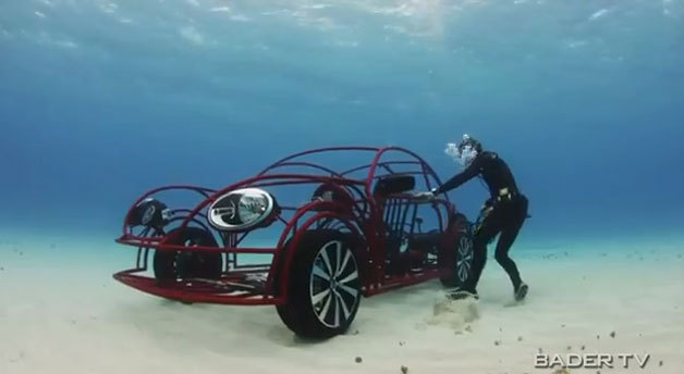 """Check out VW's wireframe Beetle swimming with sharks"" We recently told you about the Volkswagen Beetle shark cage constructed as a tie-in with Discovery Channel's Shark Week, now you can see it in action. Well, briefly – the video below spends a lot more time talking about it than actually showing it in action, but you'll just have to tune into Shark Week (next week) for that. The wireframe Beetle-shaped cage that can be driven on the ocean floor is said to be just a quarter-inch off the dimensions of a Beetle Turbo. However, probably the most important thing about any of this is that it has thrusters, which we think should absolutely be a production option starting right now. ____________________ Get in loser. We're going swimming with some fahrvergnügen sharks!"