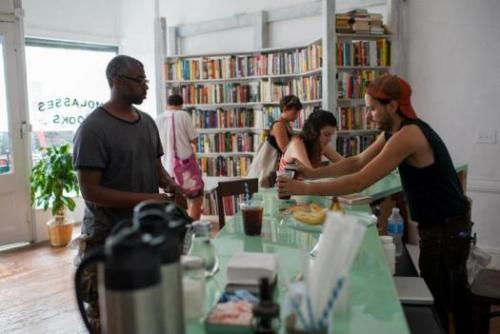 unconsumption:   Molasses Books in Bushwick, Brooklyn is a new bookstore that offers a change from the traditional retail model, letting customers trade their books for a coffee tab or even more books. The store owner, Matthew Winn, is also applying for a tavern license, which will enable them to swap for beer and wine in the future as well.  (via Brooklyn Bookstore Lets You Trade Paperbacks For Coffee - PSFK)