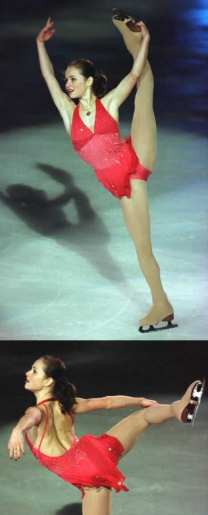 Sasha Cohen skating to One Day I'll Fly Away in the 2002 Trophée Lalique gala. Photos by Barry Mittan. 1 and 2.