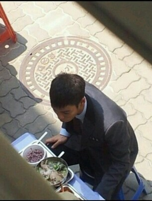 T.O.P. in a school uniform filming Alumnus Source: onetop1104@twitter