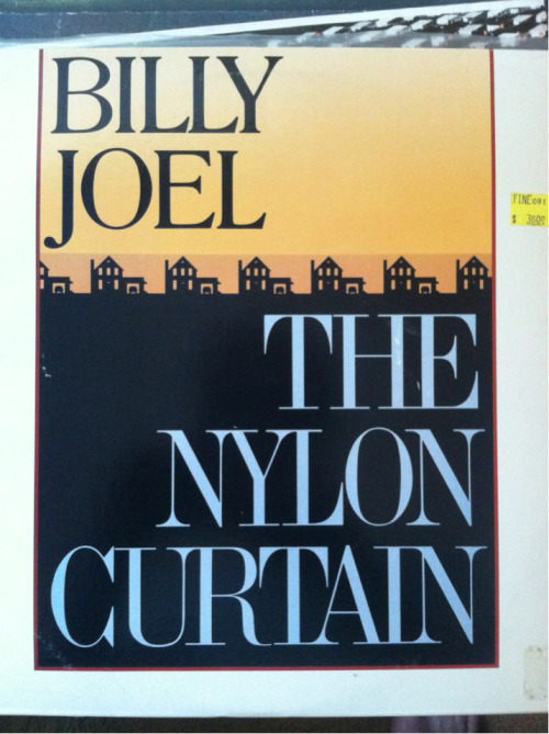 "William Joel - The Nylon Curtain  This is certainly the artistic peak for W.M. Joel, barring a very focused late period, which, you never know…he hasn't done a record since 1993, though, so…  To date, then, this is his best record, and he does have a few solid contenders; if you simply forget that ""A Room Of Our Own"" is on here, you could call this a 4.5/5 record, especially in context.   I've mentioned on here previously that I've been thinking of this, EC's ImperialBedroom, and Paul Simon's Hearts and Bones as thematically linked by the pall cast over them all by John Lennon's murder. All three reference the event (although Elvis is the most elliptical (in ""Kid About It"")…elliptical unless you remember that his producer on ImperialBedroom was Geoff Emerick, The Beatles' engineer…And that George Martin came and helped with the orchestral bit on ""…And In Every Home"", which is nearly as good as The Rutles). Paul Simon references it directly in ""The Late Great Johnny Ace"", but with Mr Joel here, it is an attempt to reach the grandiose production scale of The Beatles' best work which shows where his head was at.   Lots of the songs employ techniques which you would immediately pick out as Beatlesque: the George Martin strings and Lennony melody of ""Scandinavian Skies"", the sound effects painting in ""Allentown"" and ""Goodnight Saigon"", the entirety of the excellent ""Laura"", the list goes on. None of the songs here seem to reference the event lyrically, but the production is so specifically Beatles-heavy, it's clear what was on this New Yorker's mind.  It is interesting to note that this was the first record made entirely on digital recording equipment, rather than onto big tape, although I believe I remember one of the instructors at Recording School (TM) saying that the producer, Phil Ramone, eventually introduced tape hiss noise into the final mixes because it sounded ""too clean"". Perhaps that's simply convenient analog tape nerd urban myth. The world may never care.  The Nylon Curtain is a very worthy record, with well-built songs, great tones, and played with some passion; it starts well and ends well, hits some highs and no real lows…A Room of Our What-did-you-say-now notwithstanding, this record has found its way into my Amorphous Top 32 Records Of All Time (TM).   Welcome to the list, William Joel. Welcome."