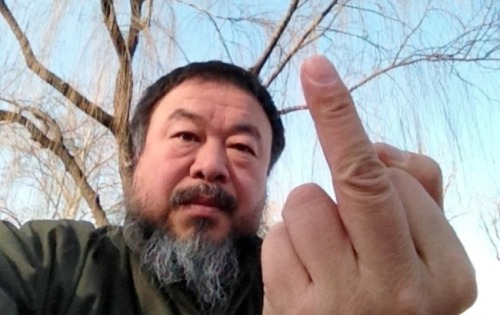 'Ai Weiwei: Never Sorry' – purely engrossing cinema Ai Weiwei: Never Sorry Directed by Alison Klayman Written by Alison Klayman USA, 2012 Some concepts in modern life can feel maudlin and totally appropriate at the same time. One such idea, one that deserves more importance among our young generation, is that a single person can make a difference in the world. No matter how corny this sounds, the idea is exemplified by the excellent new documentary Ai Weiwei: Never Sorry, profiling the lightning-rod artist and activist Ai Weiwei as he rails against the police-state environment in China and meets resistance at all sides. Ai Weiwei, only a few years ago, was at a creative and commercial peak, having been commissioned by the Chinese government to help design the Bird's Nest, the stadium that would serve as the centerpiece of the 2008 Beijing Summer Olympics. But after bringing the stadium to life, Ai made inflammatory artwork against the Olympics and the government by literally giving the Bird's Nest the finger. This set off a chain of events that led him on a crusade against police and the dictatorial Chinese government, all documented by the artist and by Ai Weiwei: Never Sorry's director, co-editor, and cinematographer, Alison Klayman. Klayman uses her unprecedented access into Ai's life and methods to craft a taut, compelling, and infuriating story of activism in the face of impossible adversity. CLICK HERE TO EXPAND THE ARTICLE