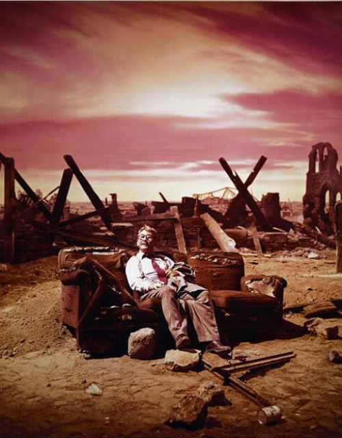 "(via Adventures in the Vast Wasteland #40)  Burgess Meredith, in rare color still, while shooting the episode ""Time Enough at Last"" from the first season of the The Twilight Zone."