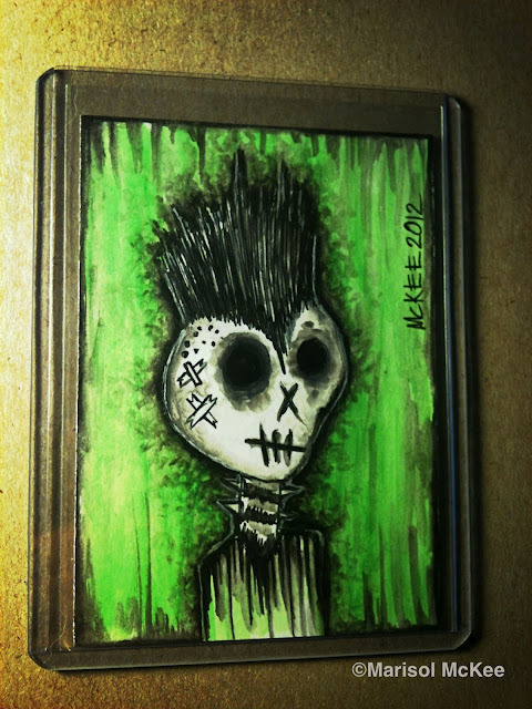 "Sid Bone.2.5 x 3.5"" or 6 cm x 9 cm.Watercolors and ink on 110 lb. acid-free paper.Signed on the front; title and signature on the back.Sealed with a matte finish.Comes in a clear rigid plastic top-loader.©Marisol McKee. Available here."