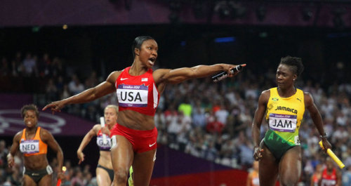 Carmelita Jeter - pointing as USA smashes 4x100m world record - London 2012