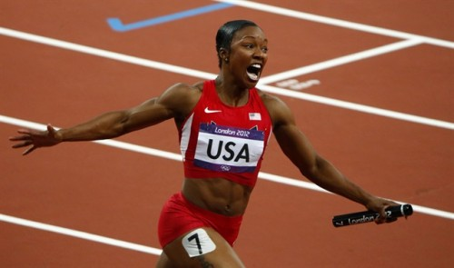 inothernews:  FAST AND FURIOUS  Carmelita Jeter of the U.S. celebrates after the U.S. won the women's 4x100m relay — and set a new world record of 40.82 seconds, breaking the mark set by East Germany in 1985.  (Photo: David Gray / Reuters via NBC)