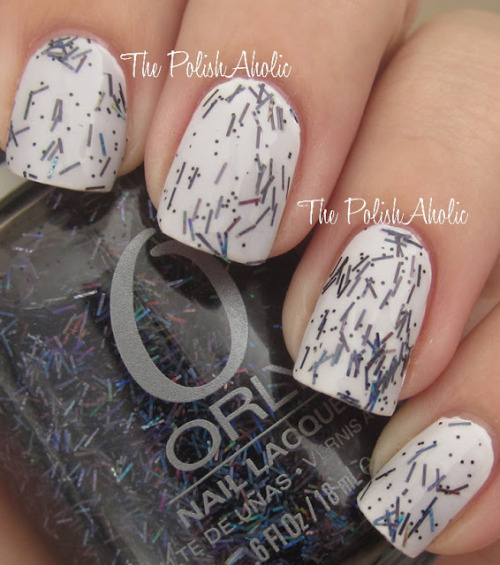 ORLY from Glam FX collection called Sunglasses at Nigh. it is a black and navy blue bar glitter and i want it.