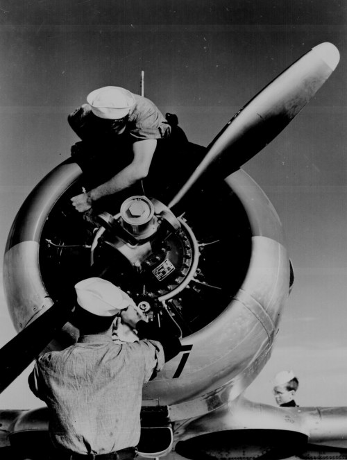 collective-history:  Mechanics check engine of SNJ at Kingsville Field, NATC, Corpus Christi, Texas ca. 1942. National Archives