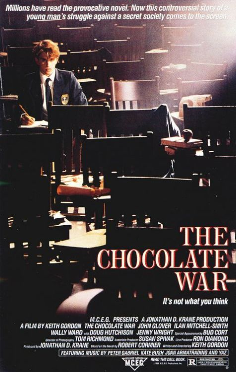 Chocolate War (1988)  New boy at strict Catholic High School, Jerry Renault, is bullied into selling boxes of chocolates for the school's annual fund-raising event. The sadistic headmaster, Brother Leon, and 'The Vigils', a viscious gang of school thugs, make Jerry's life hell when he decides he won't be pushed around anymore.  Cast: John Glover, Ilan Mitchell-Smith, Wallace Langham, Doug Hutchison Follow this blog for the neverending list of all the teen movies ever made!