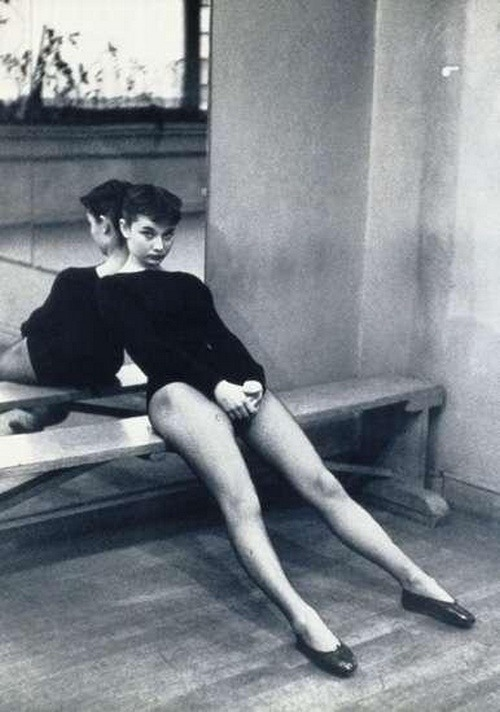 theniftyfifties:  Audrey Hepburn takes a break during dance class, 1950s.  :)
