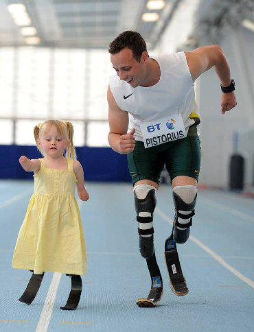 Amazing photo of South African Olympic Athlete Oscar Pistorius sharing a moment with a young quadruple amputee.