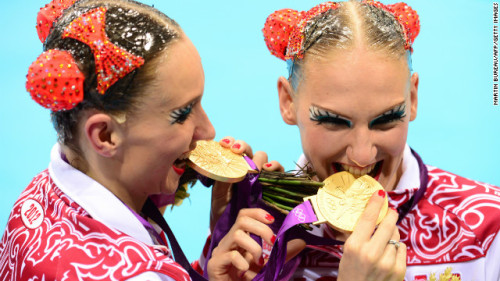 Perhaps sell the medal and pay for a better make up artist?