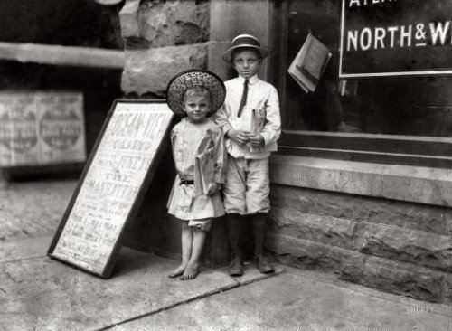"June 1911; Norfolk, VA, USA; ""Gus Hodges, age 11, instructing his brother Julius, age 5, in the finer points of Street Vending. Gus sells as late as 9 pm, and he said that he made over one dollar a day. Julius and another brother, 9 years old, had made 25 cents that day."" Photo by Lewis Wickes Hine. via"