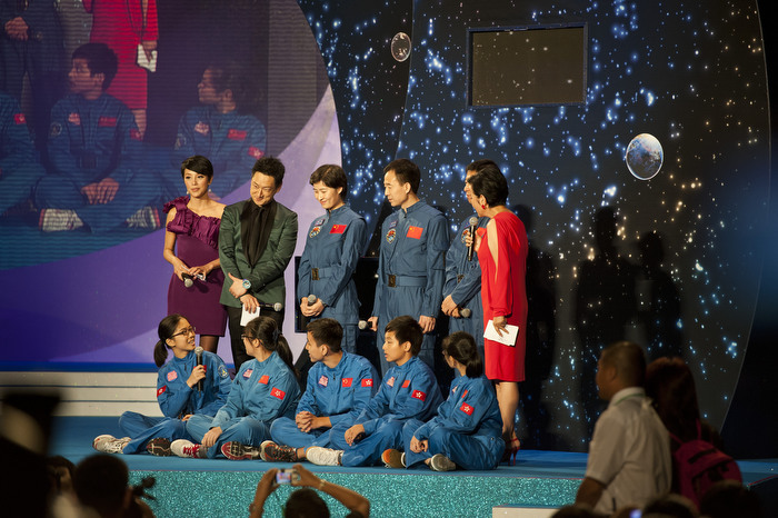 HONG KONG: Aug. 11, 2012 — Students ask the China's astronaut team their experiences in space during a TV show broadcast to welcome the men and women behind China's first manned space docking mission between the orbiting experimental space station Tiangong-I and the Shenzhou-IX spacecraft in Hong Kong Saturday, Aug. 11, 2012. (Photo by JUSTIN CHIN)