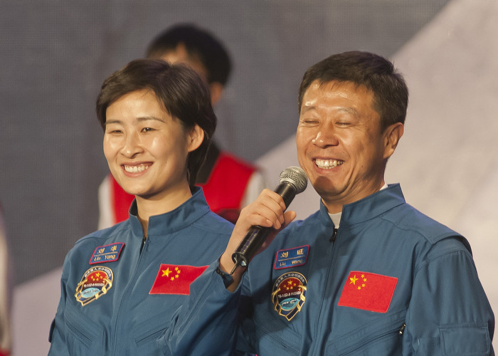 HONG KONG: Aug. 11, 2012 — Wearing blue jumpsuits, astronauts Liu Yang (left), the nation's first woman in space, and Liu Wang, attends a TV show broadcast during their four days visit in Hong Kong Saturday, Aug. 11, 2012. (Photo by JUSTIN CHIN)