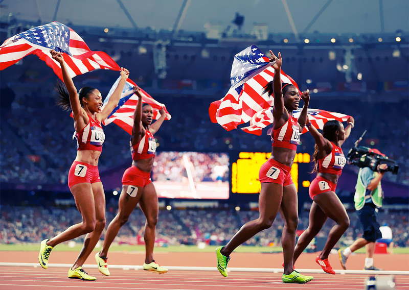 OLYMPICS DAY 14USA women's 4x100m Relay team celebrate their gold medal win Photo byJamie Squire