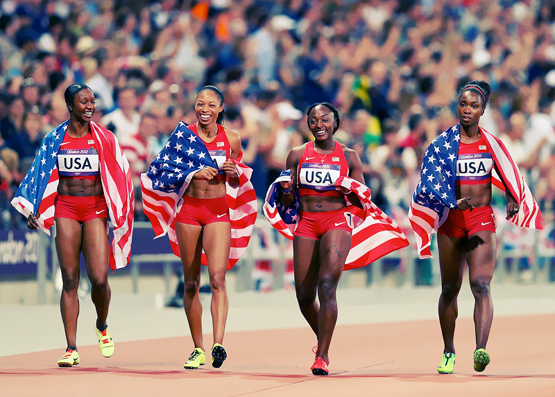 OLYMPICS DAY 14Carmelita Jeter, Allyson Felix, Bianca Knight and Tianna Madison celebrate their 4x100m gold medal win Photo byRyan Pierse