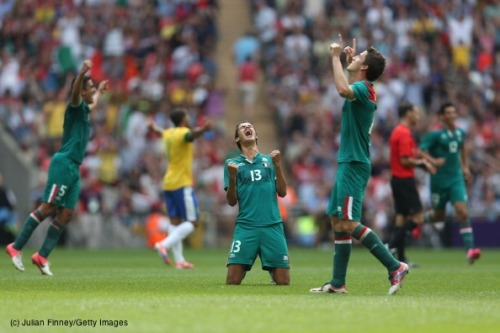 Diego Reyes of MEX celebrates winning the gold medal after victory in the Men's Football between MEX and BRA