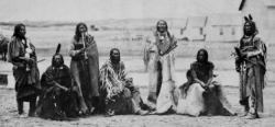 Participants in Treaty Negotiations at Ft. Laramie in Wyoming - 1868L-R: Spotted Tail I (Sicangu Lakota), Roman Nose (aka They Are Afraid Of His Shield) (Mniconjou Lakota), Old Man Afraid of His Horses (Oglala Lakota), Lone Horn (Mniconjou Lakota), Whistling Elk (Mniconjou Lakota), Pipe (Oglala Lakota), Slow Bull (Oglala Lakota)