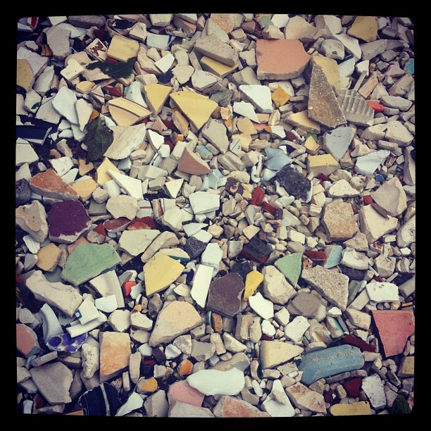 Broken pottery makes this parking lot surface beautiful  (Taken with Instagram at Angel Foods)
