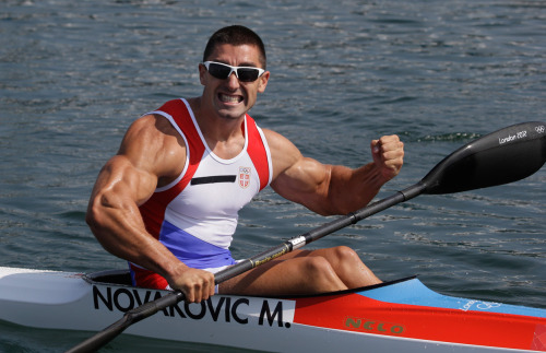 bicepsbiceps:  Serbia's Marko Novakovic celebrates his third place finish in men's kayak