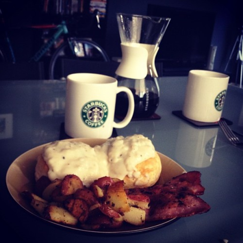 Rosemary Biscuits and Truffle Gravy with British bacon and potatoes. #breakfast #food #foodporn #whatsoneeating  (Taken with Instagram at Ritz Charleston)
