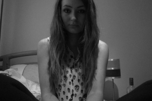Bored. Ready and waiting to party. Pre drinking by myself isn't sad, is it?