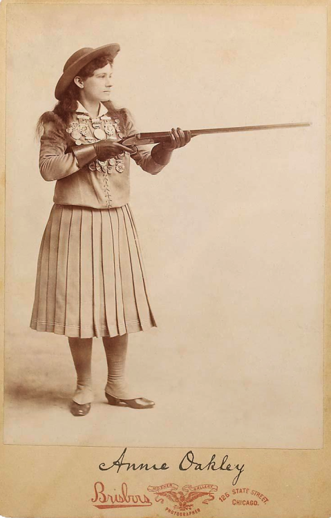 zippalu:  Annie Oakley, Famous Sharpshooter    Annie and her gun. And what I assume are a LOT of shooting medals.