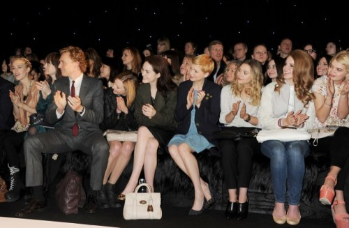 tom-sits-like-a-whore:  I am crying with laughter. Look at the girl sitting to Tom's right! She's positively squashed! And all because he's sitting like a hooker. It's even more noticeable because all the ladies next to him are sitting so demurely with their crossed legs.  Tom, just close them. Give the poor girl a chance to breathe!  Oh my GOD, he looks like a giant next to everyone! I also like Lana Del Rey casually sitting down there!