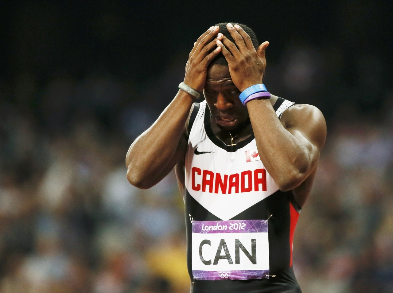 "Canada has been disqualified from the final of the men's 4×100-metre relay at the London Olympics after initially appearing to win the bronze medal. The team of Gavin Smellie of Brampton, Ont., Ottawa's Oluseyi Smith, Jared Connaughton of New Haven, P.E.I., and anchor Justyn Warner of Markham, Ont., brought out the Maple Leaf to celebrate after posting a time of 38.07 seconds. But the team was disqualified after it appeared Connaughton stepped out of his lane. ""It was my fault,"" he told reporters after the race. The DQ gave the bronze to Trinidad and Tobago, leaving the Canadians doubled over on the track in tears."