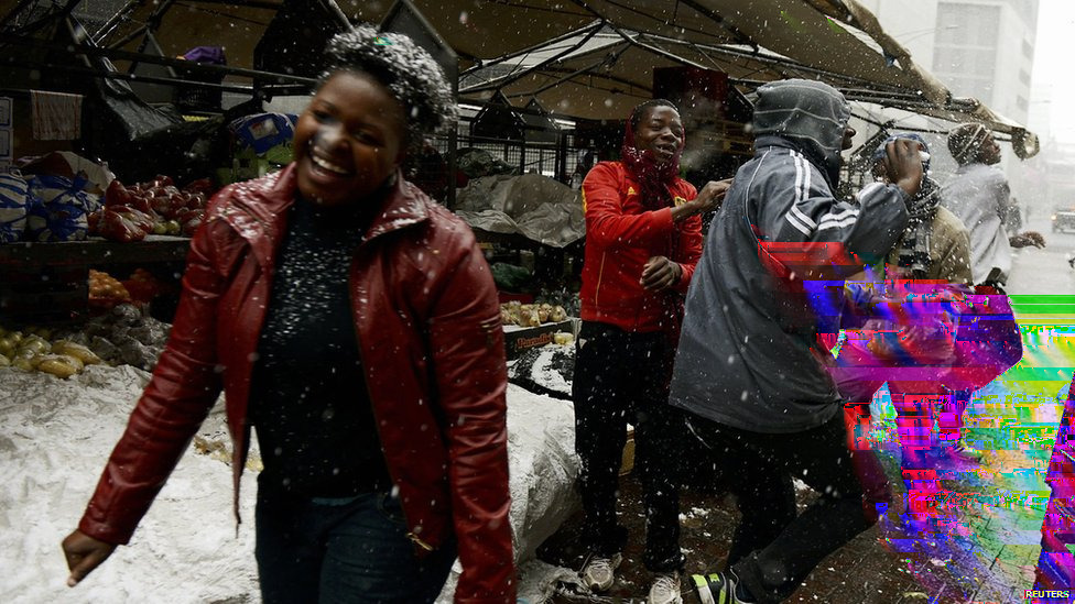 "Rare snow fell in and around South Africa's city of Johannesburg on Tuesday. It began snowing in the morning and flurries continued all day.  Some said they had never seen snow before.  ""Amazing. Never happened in my life,"" security guard Mizundile Eseu, 23, told the AFP news agency."