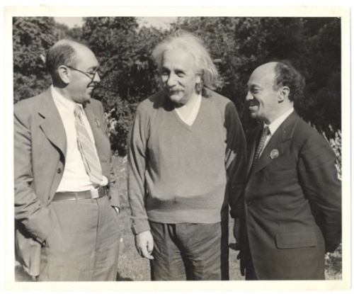 "Itsik Fefer and Shlomo Mikhoels meet with Albert Einstein. Princeton, 1943. (via YIVO Archives)   Itsik Fefer (1900–1952), Yiddish poet. Born in Shpola, Ukraine, Itsik Fefer was 12 years old when he began to work at a printing shop. In 1917 he joined the Bund and became a trade union activist. A Communist from 1919, he served in the Red Army. He began writing poems in 1918, and in 1922 joined Vidervuks (New Growth) in Kiev, a group of young Yiddish literati whose mentor was Dovid Hofshteyn. Fefer was known for his literary credo of proste reyd (simple speech), a concept he formulated in 1922. In the early 1920s, poetry, particularly avant-garde poetry, swamped the literary pages of Soviet Yiddish periodicals. This phenomenon worried editors and critics, who were wary of the fact that Yiddish readers usually could not identify with this style of literature. All Yiddish readers, by contrast, could understand Fefer's proste reyd. Fefer published his poetic cycle Bliendike mistn (Manure in Bloom) in 1929, which he presented as a travelogue of a trip he took back to Shpola. He believed that the shtetl could be revitalized as a center of Jewish life and culture and could be the grounds for a new Soviet Jewish nation. Yet his poetic eye did not overlook general industrialization projects, and he was happy to see young Jewish men and women among the romantic builders of Communist society. In the 1930s, Fefer also concentrated on the Birobidzhan nation-building project; his book Birobidzhaner lider (Birobidzhan Poems) was published in 1939. At the same time, he wrote many lyrical poems, some of which were set to music. During World War II, Fefer was an agent of the secret police on the Jewish Anti-Fascist Committee (JAC). In 1943, he and Solomon Mikhoels, the committee's chair, visited the United States, Canada, Mexico, and England, successfully mobilizing pro-Soviet support. National pride runs through his poetry of that period. The poem ""Ikh bin a Yid"" (I Am a Jew) is the best-known sample of such Soviet Jewish patriotism. Fefer includes in his Soviet Jewish genealogy such figures as Bar Kokhba, King Solomon, Baruch Spinoza, Isaak Levitan, Iakov Sverdlov, and Lazar Kaganovich. In his 1948 poem ""A vending tsu Peretsn"" (An Address to Peretz), Fefer declares a pedigree of Soviet Yiddish literature. He crowns Y. L. Peretz as the genius of Yiddish literature, whereas Sholem Aleichem, the central figure in the Soviet Yiddish literary canon, appears only as part of Peretz's entourage, which also includes Ḥayim Naḥman Bialik, Dovid Bergelson, and Der Nister. As did many Soviet Jews, Fefer enthusiastically welcomed the establishment of the State of Israel. He argued that the new state was the concern of the entire Jewish people and that the heroism of Soviet people contributed more to its creation than American Zionism. In the late 1940s, however, Stalin's regime had no use for Communists who cherished Jewish national hopes. Fefer was arrested in 1948, together with other members of the JAC. He was executed on 12 August 1952. In the 1990s, the publication of archival materials dealt a blow to the posthumous reputation of Fefer: during the persecution of the JAC, his testimony was central to the prosecution's case. (via YIVO)"