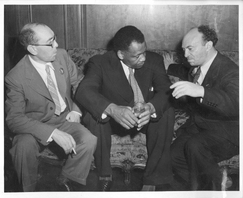 "Soviet Yiddish writer Itsik Fefer, singer/actor/activist Paul Robeson, and the legendary Soviet Yiddish actor Solomon Mikhoels at the Soviet Consulate, 1943. (via Milken Archive)  The American concert singer and actor Paul Robeson met Feffer on July 8, 1943 in New York during a Jewish Anti-Fascist Committee event chaired by Albert Einstein, one of the largest pro-Soviet rallies ever held in the United States. After the rally, Paul Robeson and his wife Eslanda Robeson, befriended Feffer and Mikhoels. Six years later, in June 1949, during the 150th anniversary celebration of the birth of Alexander Pushkin, Robeson visited the Soviet Union to sing in concert. According to David Horowitz,  ""In America, the question 'What happened to Itzhak Feffer?' entered the currency of political debate. There was talk in intellectual circles that Jews were being killed in a new Soviet purge and that Feffer was one of them. It was to quell such rumors that Robeson asked to see his old friend, but he was told by Soviet officials that he would have to wait. Eventually, he was informed that the poet was vacationing in the Crimea and would see him as soon as he returned. The reality was that Feffer had already been in prison for three years, and his Soviet captors did not want to bring him to Robeson immediately because he had become emaciated for lack of food. While Robeson waited in Moscow, Stalin's police brought Feffer out of prison, put him the care of doctors, and began fattening him up for the interview. When he looked sufficiently healthy, he was brought to Moscow. The two men met in a room that was under secret surveillance. Feffer knew he could not speak freely. When Robeson asked how he was, he drew his finger nervously across his throat and motioned with his eyes and lips to his American comrade. They're going to kill us, he said. When you return to America you must speak out and save us.""  During his concert in Tchaikovsky Hall on June 14 - which was broadcast across the entire country - Robeson publicly paid tribute to Feffer and the late Mikhoels, singing the Vilna Partisan song ""Zog Nit Keynmol"" in both Russian and Yiddish. Recordings of the concert survived but Robeson's spoken words are lost. (via Wikipedia)"