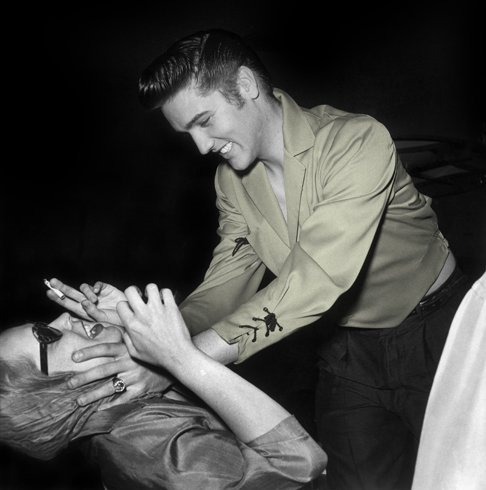 theniftyfifties:  Vampira gets assaulted by Elvis Presley, Las Vegas, May 1956.